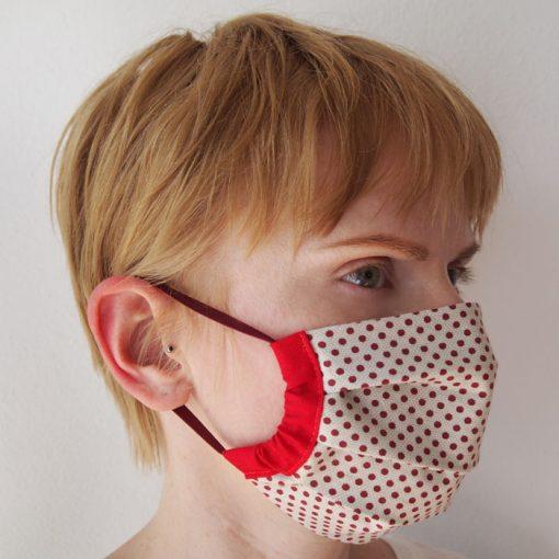 Biele bavlnené rúško na tvár s červenými bodkami